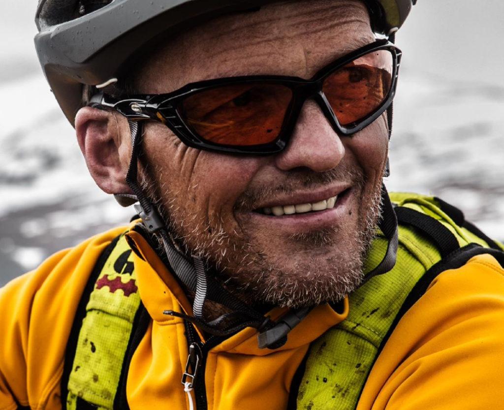 Widex hearing aid being worn by a man mountain biking